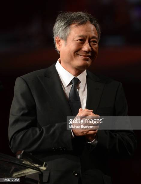 Director Ang Lee presents the Frederick Loewe Award for Film Composing onstage during the 24th annual Palm Springs International Film Festival Awards...