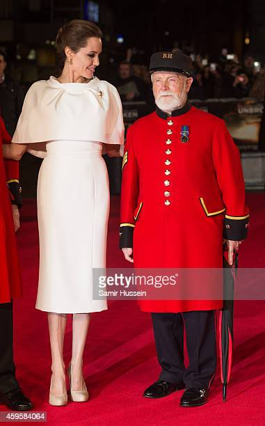 "Director Angelina Jolie poses with Chelsea Pensioner James Walter Fellows at the UK Premiere of ""Unbroken"" at Odeon Leicester Square on November 25,..."
