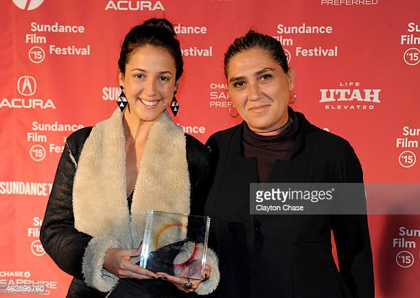 Director Anna Muylaert and actress Camila Mardila of 'The Second Mother' pose with the World Cinema Special Jury Prize for Acting on behalf of Regina...