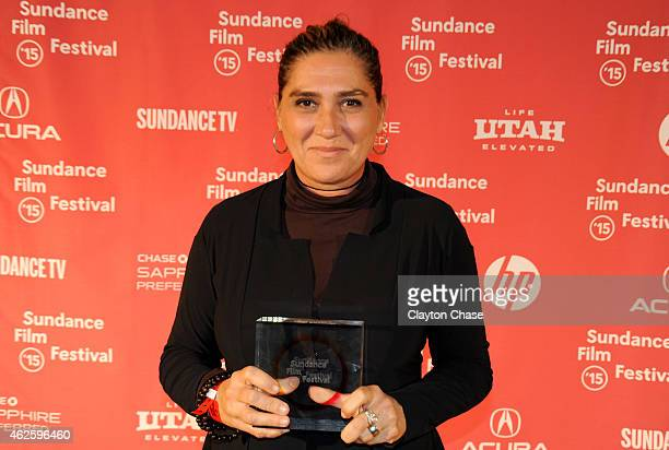 Director Anna Muylaert of 'The Second Mother' poses with the World Cinema Special Jury Prize for Acting on behalf of Regina Case and Camila Mardila...