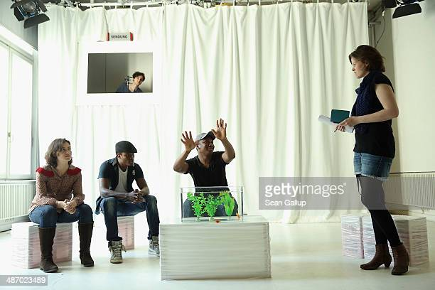 """Director Anna-Katharina Schroeder instructs cast members of """"GRENZFAeLLE"""", a play that stars African refugees and German actresses, during a..."""