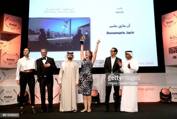 Director Annemarie Jacir celebrates with the Muhr Best Fiction Feature award for Wajib with actor Mohammad Bakri HH Sheikh Mansoor bin Mohammed bin...