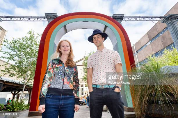 Director Annie Rigby and singer and composer Paul Smith pose during a photocall to promote the show 'Unfolding Theatre Hold On Let Go' during...