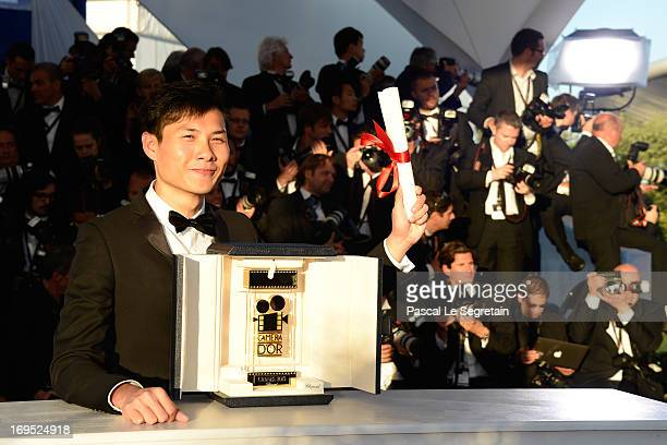 Director Anthony Chen poses with the 'Camera d'Or' for Best First Film at the Palme D'Or Winners Photocall during the 66th Annual Cannes Film...