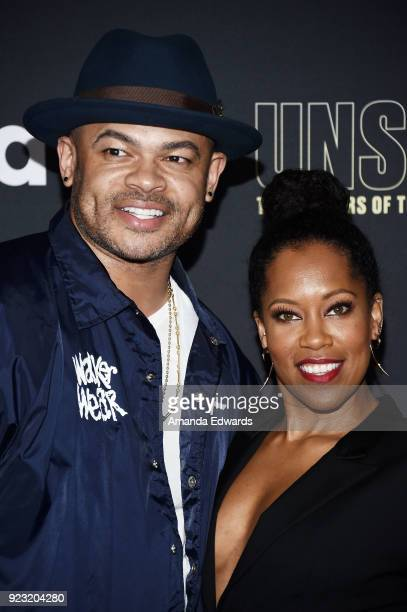 Director Anthony Hemingway and actress Regina King arrive at the premiere of USA Network's 'Unsolved The Murders of Tupac and The Notorious BIG' at...