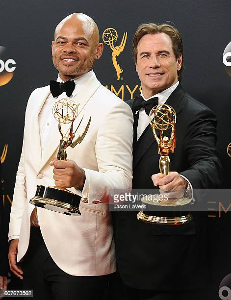 Director Anthony Hemingway and producer John Travolta pose in the press room at the 68th annual Primetime Emmy Awards at Microsoft Theater on...