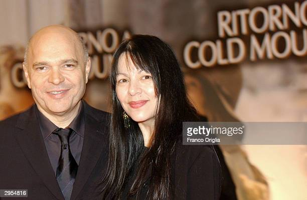 Director Anthony Minghella and his wife attend the Italian premiere of 'Cold Mountain' at the Warner Moderno Cinema on February 9 2004 in Rome