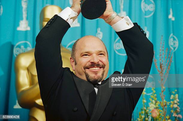 Director Anthony Minghella holds high the Oscar he won for Best Director for The English Patient The film also won the Best Picture Oscar at the 69th...