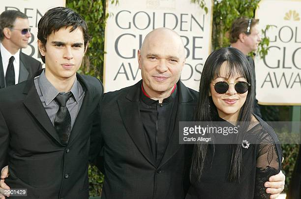 Director Anthony Minghella with wife Caroline and son Max attend the 61st Annual Golden Globe Awards at the Beverly Hilton Hotel on January 25 2004...