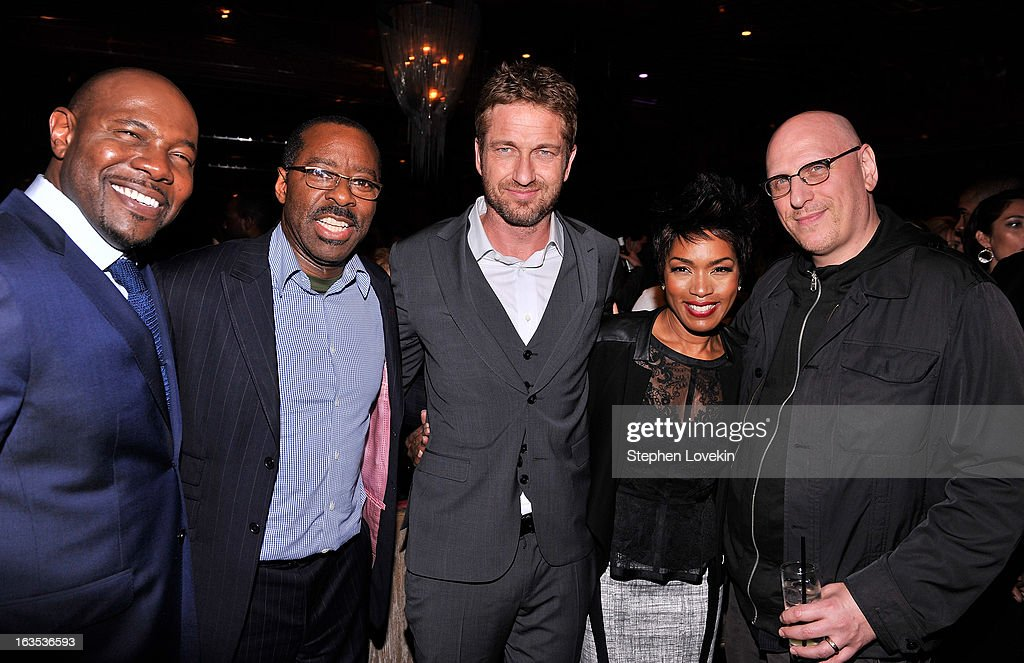 Director Antoine Fuqua, actor Courtney B. Vance, actor Gerard Butler, actress Angela Bassett, and filmmaker Oren Moverman attend the after party for The Cinema Society with Roger Dubuis and Grey Goose screening of FilmDistrict's 'Olympus Has Fallen' at The Darby on March 11, 2013 in New York City.
