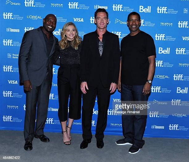 Director Antoine Fuqua actress Chloe Grace Moretz actor Marton Csokas and actor Denzel Washington pose at The Equalizer Press Conference during the...