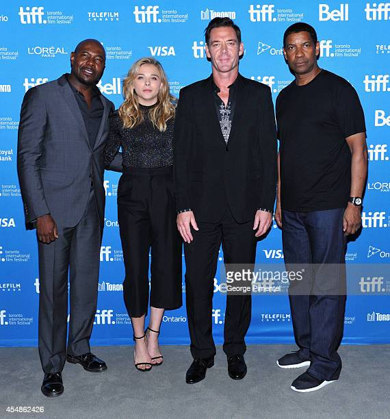 "Director Antoine Fuqua, actress Chloe Grace Moretz, actor Marton Csokas and actor Denzel Washington pose at ""The Equalizer"" Press Conference during..."