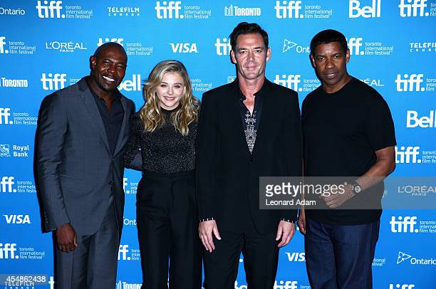 Director Antoine Fuqua actress Chloe Grace Moretz actor Marton Csokas and actor Denzel Washington pose at 'The Equalizer' Press Conference during the...