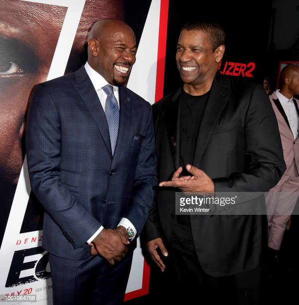 Director Antoine Fuqua and actor Denzel Washington arrive at the premiere of Columbia Picture's 'Equalizer 2' at the Chinese Theatre on July 17 2018...