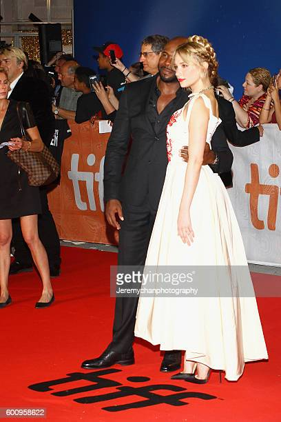 Director Antoine Fuqua and actor Haley Bennett attends the 'The Magnificent Seven' premiere held at Roy Thomson Hall during the Toronto International...