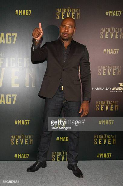 Director Antoine Fuqua attends 'The Magnificent Seven' red carpet and photo call at the ArtScience Museum at Marina Bay Sands on June 15 2016 in...