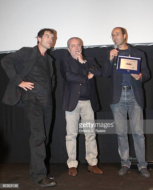 Director Antonello Matarazzo producer Aurelio De Laurentiis and director Bruno Di Marino with the Hag Award for 'Latta E Caffe' at the Collateral...