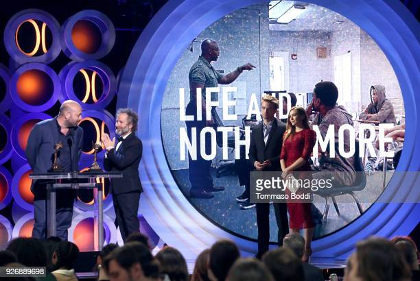 Director Antonio Mendez Esparza and producer Pedro Hernandez Santos accept the John Cassavetes Award for 'Life and Nothing More' onstage during the...