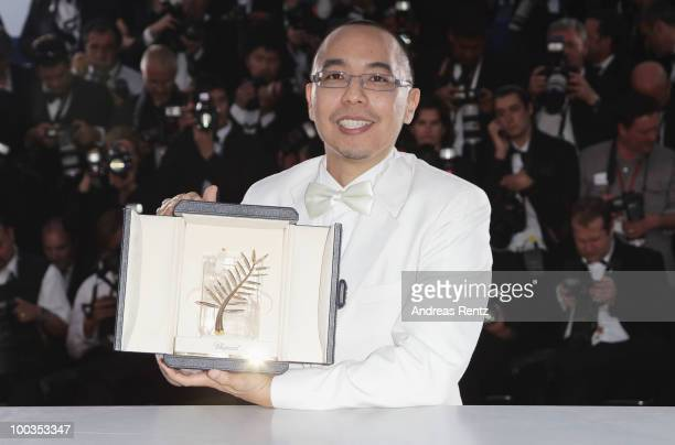 Director Apichatpong Weerasethakul poses with his Palme d'Or award for the film Uncle Boonmee Who Can Recall His Past Lives at the Palme d'Or Award...