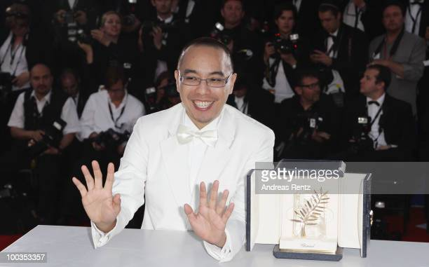 Director Apichatpong Weerasethakul poses with his Palme d'Or award for the film 'Uncle Boonmee Who Can Recall His Past Lives' at the Palme d'Or Award...