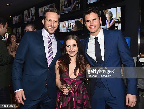 Director Ari Sandel actress Mae Whitman and actor Robbie Amell attend the after party for a Fan Screening of CBS Films' The Duff at Dave Busters on...