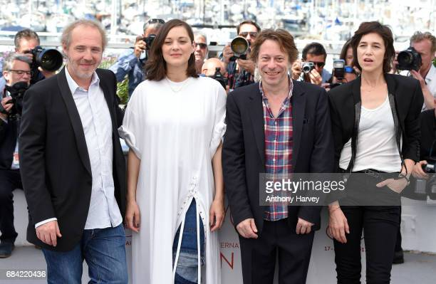 Director Arnaud Desplechin actors Marion Cotillard Mathieu Amalric and Charlotte Gainsbourg attend the 'Ismael's Ghosts ' photocall during the 70th...