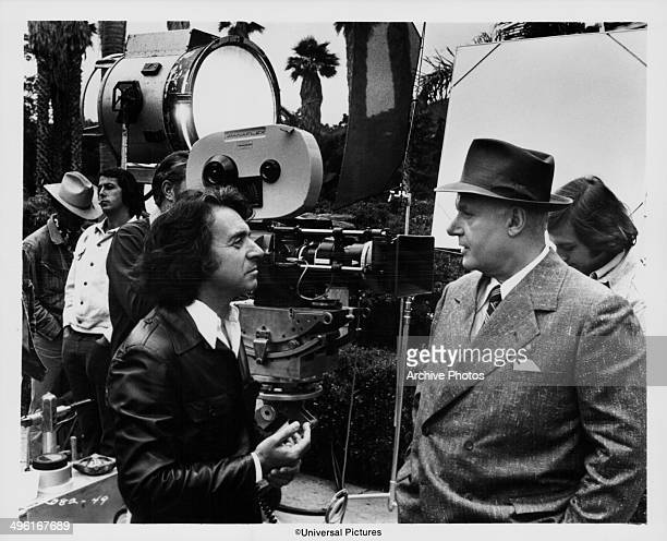 Director Arthur Hiller and actor Rod Steiger talking on the set of the movie 'W C Fields and Me', 1976.
