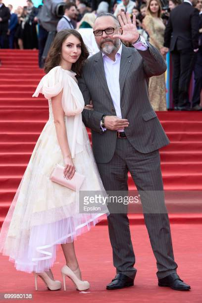 Director artistic director of Modern theater Yury Grymov with the daughter Antonina attend opening of the 39th Moscow International Film Festival...