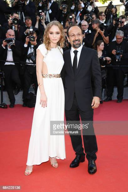 Director Asghar Farhadi and LilyRose Depp attend the 'Ismael's Ghosts ' screening and Opening Gala during the 70th annual Cannes Film Festival at...