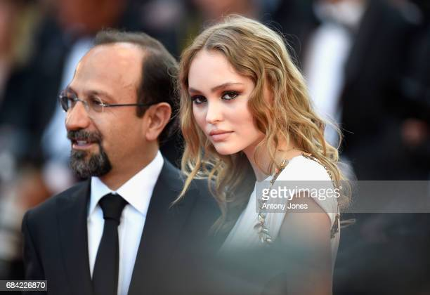 Director Asghar Farhadi and LilyRose Depp attend the Ismael's Ghosts screening and Opening Gala during the 70th annual Cannes Film Festival at Palais...