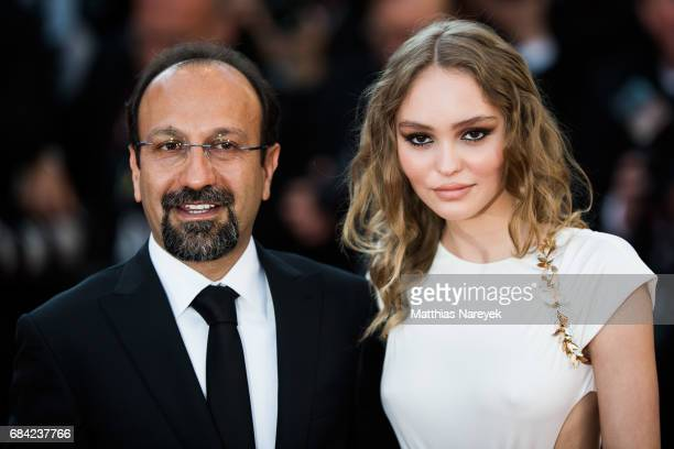 Director Asghar Farhadi and LilyRose Depp attends the Ismael's Ghosts screening and Opening Gala during the 70th annual Cannes Film Festival at...