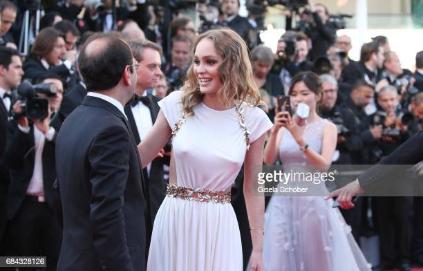 """Director Asghar Farhadi and Lily-Rose Depp, daughter of Johnny Depp attend the """"Ismael's Ghosts """" screening and Opening Gala during the 70th annual..."""