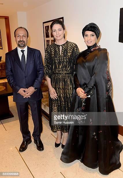 Director Asghar Farhadi Hanaa Issa and Doha Film Institue CEO Fatma Al Remaihi pose prior to the The Salesman Premiere at the annual 69th Cannes Film...