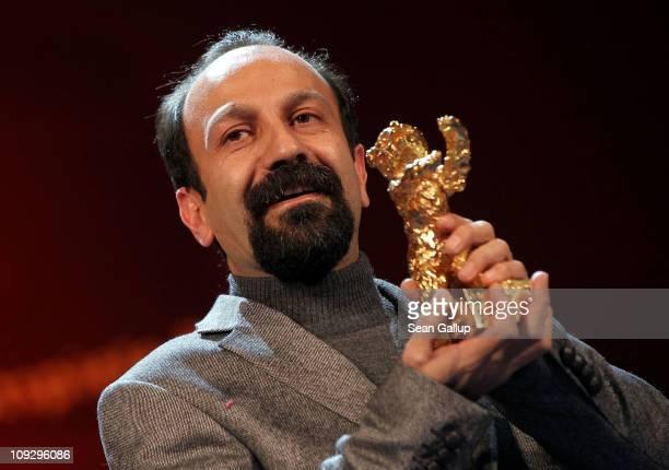 Director Asghar Farhadi of Iranian movie 'Jodaeiye Nader Az Simin' receives the Golden EBar for best movie at the Award Ceremony during day ten of...