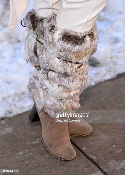 Director Ashley Avis wearing ecoRidge Hideaway legwarmers with Cole Haan boots is seen at the 2014 Film Festival on January 17 2014 on the streets of...