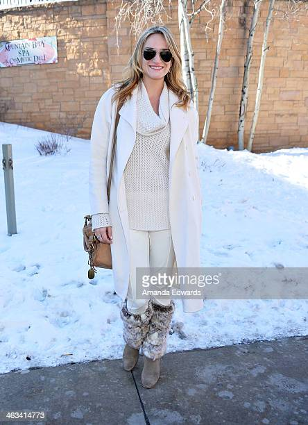 Director Ashley Avis wearing RayBan sunglasses a Calvin Klein coat an Andrew Marc bag and ecoRidge Hideaway legwarmers with Cole Haan boots is seen...
