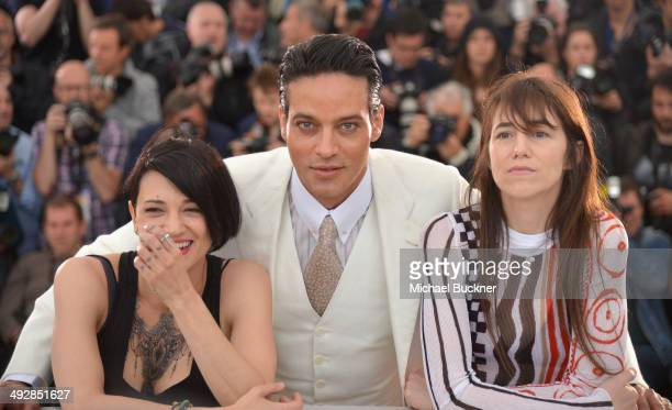 Director Asia Argento and actors Gabriel Garko and Charlotte Gainsbourg attend the 'Misunderstood' photocall at the 67th Annual Cannes Film Festival...