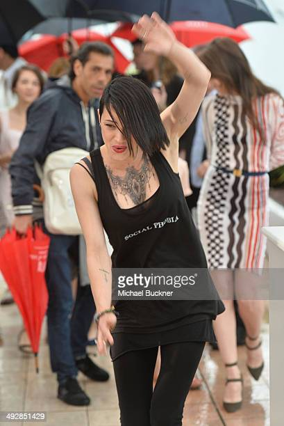 Director Asia Argento slips as she attends the 'Misunderstood' photocall at the 67th Annual Cannes Film Festival on May 22 2014 in Cannes France