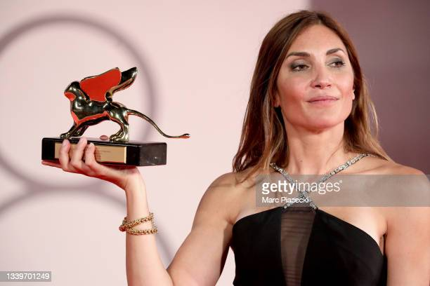 """Director Audrey Diwan poses with the Golden Lion for """"L'Evenement"""" at the awards winner photocall during the 78th Venice International Film Festival..."""