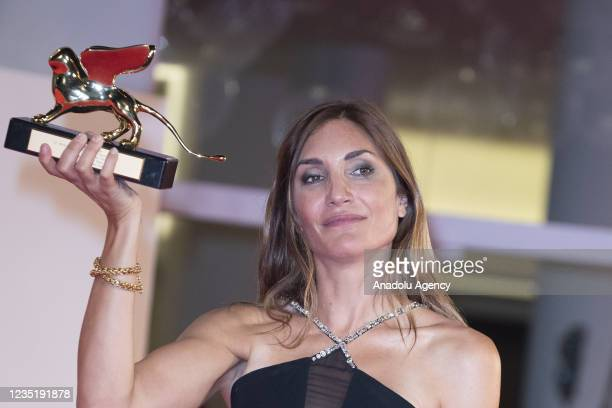"""Director Audrey Diwan receives the Golden Lion for Best Film for """"L'Evenement"""" during the closing ceremony during the 78th Venice International Film..."""