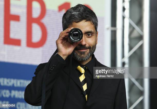 Director Babak Najafi receives the Best First Feature Award for 'Sebbe' at the 'Award Winners' Photocall during day ten of the 60th Berlin...