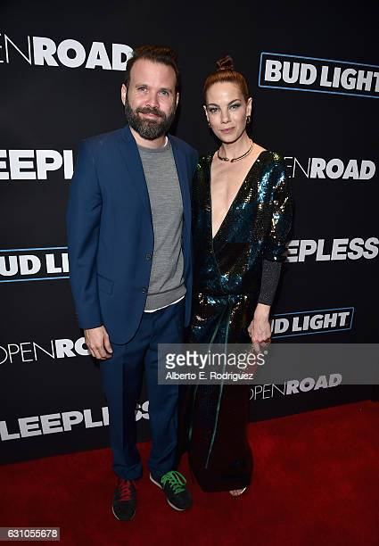 Director Baran Bo Odar and actress Michelle Monaghan attend the Premiere of Open Road Films' Sleepless at Regal LA Live Stadium 14 on January 5 2017...