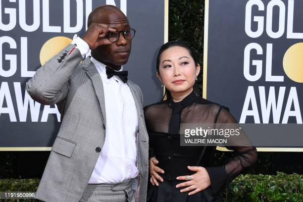 Director Barry Jenkins and partner US director Lulu Wang arrive for the 77th annual Golden Globe Awards on January 5 at The Beverly Hilton hotel in...