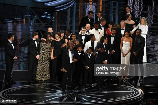 US director Barry Jenkins celebrates on stage after he won the Best Film award for Moonlight at the 89th Oscars on February 26 2017 in Hollywood...
