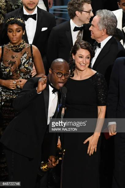 """Director Barry Jenkins celebrates on stage after """"Moonlight"""" won the Best Film award at the 89th Oscars on February 26, 2017 in Hollywood,..."""
