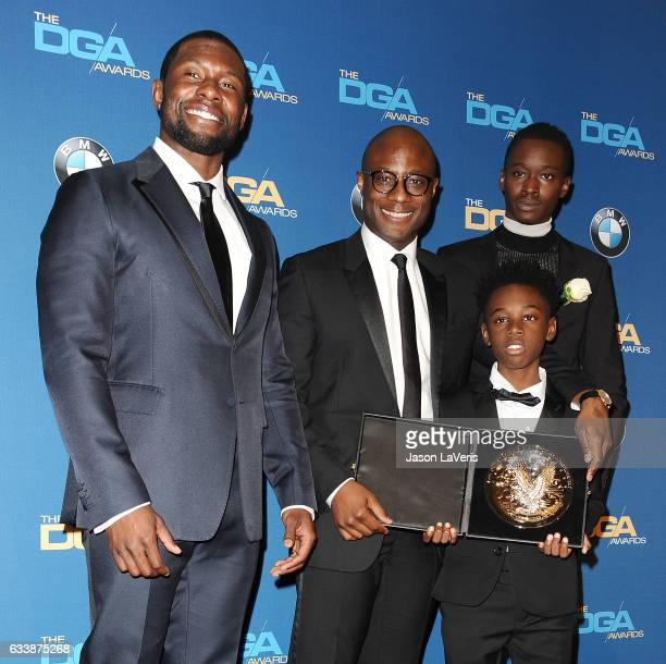 Director Barry Jenkins recipient of the Feature Film Nomination Plaque for Moonlight poses in with actors Trevante Rhodes Alex Hibbert and Ashton...