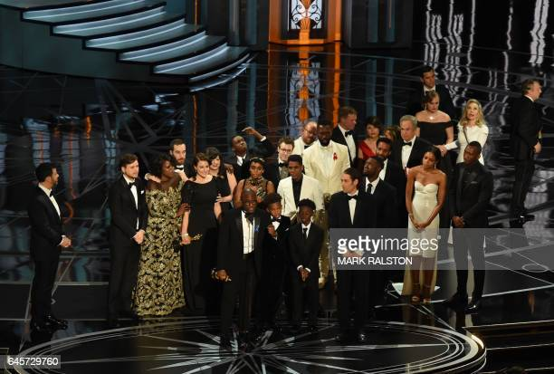 US director Barry Jenkins speaks after Moonlight won the Best Film award as Host Jimmy Kimmel looks on at the 89th Oscars on February 26 2017 in...