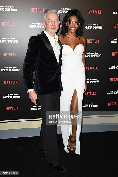 Director Baz Luhrmann and actress Herizen Guardiola arrive at the premiere of The Get Down at Lehman Center for the Performing Arts in Bronx New York...