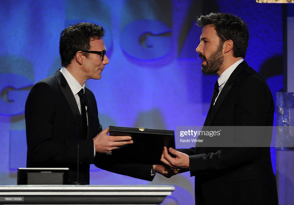 Director Ben Affleck (R) accepts the Outstanding Directorial Achievement in Feature Film for 2012 award for 'Argo' from director Michel Hazanavicius (L) onstage during the 65th Annual Directors Guild Of America Awards at Ray Dolby Ballroom at Hollywood & Highland on February 2, 2013 in Los Angeles, California.