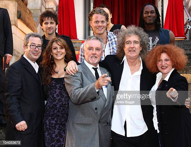 Director Ben Elton drummer Roger Taylor guitar player Brian May of Queen and the musical cast attend the 'We will rock you' musical photocall and fan...